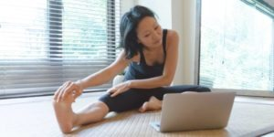 Women exercising using online yoga | yin-yoga | yin-yoga-pose