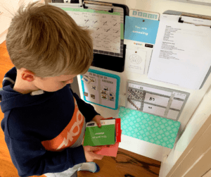 boy selecting affirmation | family-routines