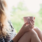 Women with cup of tea relaxing | why-a-retreat | mums-retreat