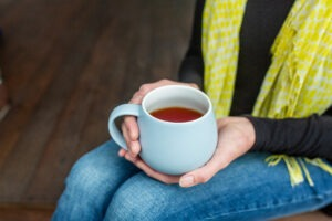 resting-with-cup-of-tea | why-declutter | how-to-declutter